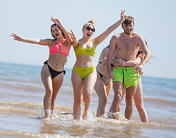 © Licensed to London News Pictures. 07/08/2020. Bridlington, UK. Tegan Bibby and Evania Ryan, Katie Johnson, Evie Adams, Millie Wright,  enjoy the hot weather on Bridlington beach this afternoon.  The UK is set to bask as temperatures today will reach 36 degrees Celsius in the capital during a mini heatwave. Photo credit: Ioannis Alexopoulos/LNP