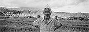 Rice Farmer with hat and his field, Bali, Indonesia, April 2000
