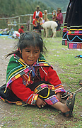 Indigenous child in colourful clothes, Cusco, Peru