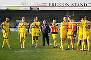 Wimbledon Manager Wally Downes watches as his players applaud the fans at full time during the EFL Sky Bet League 1 match between Scunthorpe United and AFC Wimbledon at Glanford Park, Scunthorpe, England on 30 March 2019.