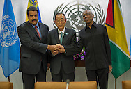 Nicolas Maduro Moros,the President of  Venezuela.and David Arthur Granger, the President of Guyana clasp hands in a gesture of unity, with United Nations Secretary General Ban Ki moon.
