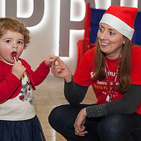 Lucy Ryan from Whitegate dancing with Santas Helper Colette Walshe while waiting for her Santa Flight at Shannon Airport