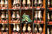 A pair of green sneakers are left as a safety deposit for the checkout of roller skates at the Intramural Activities Center at the University of Washington in Seattle, Washington.