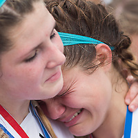 Tyler Pierce(7),left, hugs Ashlen LaCanne(19) during the awards ceremony after the lady eagles 1-0 loss to the Jasper Bulldogs in the semi finals match up in Georgetown.