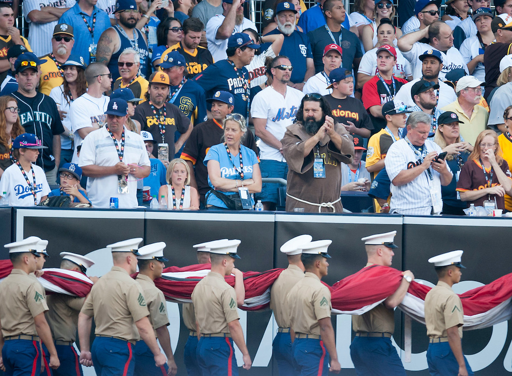 Fans cheer as Marines bring in the flag before the 2016 MLB All-Star Game at Petco Park in San Diego on Tuesday.<br /> <br /> ///ADDITIONAL INFO:   <br /> <br /> allstar.0713.kjs  ---  Photo by KEVIN SULLIVAN / Orange County Register  -- 7/12/16<br /> <br /> The 2016 MLB All-Star Game at Petco Park in San Diego.