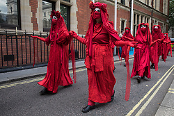Members of the Red Rebel Brigade join fellow climate activists from Extinction Rebellion at a Back The Bill rally in Parliament Square on 1st September 2020 in London, United Kingdom. Extinction Rebellion activists are attending a series of September Rebellion protests around the UK to call on politicians to back the Climate and Ecological Emergency Bill (CEE Bill) which requires, among other measures, a serious plan to deal with the UK's share of emissions and to halt critical rises in global temperatures and for ordinary people to be involved in future environmental planning by means of a Citizens' Assembly.