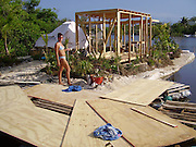 """Eco-pioneer Richard """"Rishi"""" Sowa designed and built an artificial island kept afloat by 100,000 plastic bottles.<br /> <br /> Spiral Island II is actually Rishi Sowa's second artificial island. He built the first one in 1998, near Puerto Aventuras, using 250,000 plastic bottles to keep it afloat. Sadly, his recycled island was destroyed in 2005, when Hurricane Emily passed through the area. Most of Spiral Island was washed up on the beach, but Sowa decided to build a whole new island, in a safer area.<br /> <br /> And that's how Spiral Island II came to be. With the help of volunteers, Rishi Sowa gathered around 100,000 plastic bottles and hand-built his second recycled island, in a lagoon that offers protection from bad weather. The new island features a house, beaches, 2 ponds and a solar-powered waterfall, but its creator says Spiral Island II is and always will be an eco-work-in-progress. Although smaller than its predecessor (only 20 meters in diameter), you can expect the new Spiral Island to increase in size, significantly.<br /> <br /> One of the most impressive DIY projects ever attempted, Spiral Island has inspired volunteers to come to Mexico and help Rishi Sowa improve his creation. But while some believe it a perfect environmental design, built entirely of recycled materials, there is some controversy surrounding Spiral Island. There are those who believe that if the island gets destroyed by a hurricane, again, the materials used to build it (mainly plastic bottles, sand, mangrove plants) will litter the waters of the Atlantic.<br /> Photo Shows: Stop and see Rishi and the Island at Laguna Makax, Isla Mujeres, Mexico<br /> ©Spiral Island /Exclusivepix"""