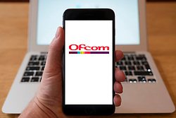 Using iPhone smartphone to display logo of Ofcom