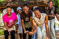 Staff members of the Lebala Safari Camp at the Kwando Concession do a traditional singing and dancing performance, Botswana.