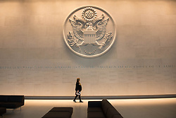 Review of the Year 2017: December: A woman walks beneath a giant cast of the Great Seal of the United States, (used to authenticate certain documents issued by the US federal government), inside the new US Embassy in south London before it opens for business in January 2018.