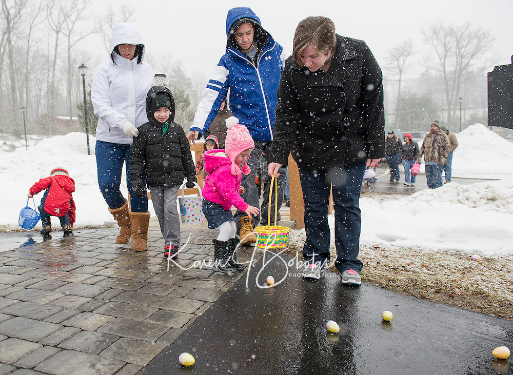 Just steps over the bridge brings children into the Easter Egg hunting zone at the Weirs Community park Easter Egg hunt on Saturday morning.  (Karen Bobotas/for the Laconia Daily Sun)