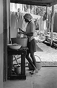 Girl washing clothes - Port Antonio