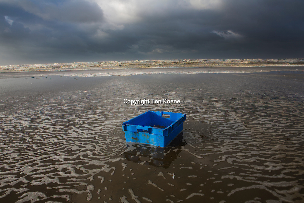 fish box fell from a fishing boat and washed at the dutch beach
