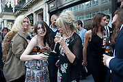 ANNA ABRAMOVICH; JO WOOD, Private view and Summer party for Scream Now. An exhibitio of new work by gallery artists. Bruce French,, Derrick Santini, Greg Miller, Malgosia Stepnik, Pakpoom Silaphan, Petroc Sesti, Russell Young. Scream. Bruton st. London. 4 August 2011. <br /> <br />  , -DO NOT ARCHIVE-© Copyright Photograph by Dafydd Jones. 248 Clapham Rd. London SW9 0PZ. Tel 0207 820 0771. www.dafjones.com.
