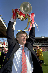 FILE PHOTO: Arsene Wenger is to leave Arsenal at the end of the season, ending a near 22-year reign as manager<br /><br />Arsenal manager Arsene Wenger celebrates winning the Premiership with the Trophy  ... Soccer - FA Carling Premiership - Arsenal v Everton  ... 03-05-1998 ...   ... None ... Photo credit should read: Tony Marshall/EMPICS Sport. Unique Reference No. 274813 ... Soccer - Premiership - Arsenal v Everton<br />Arsenal manager <br />Arsene Wenger <br />celebrates winning <br />Premiership Trophy