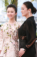 Zhang Huiwen and Gong Li at the photo call for the film Coming Home at the 67th Cannes Film Festival, Tuesday 20th May 2014, Cannes, France.