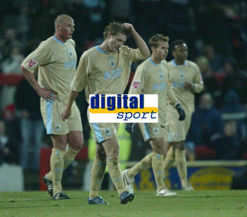 Photo: Aidan Ellis.<br /> Doncaster Rovers v Bristol City. Coca Cola League 1.<br /> 26/11/2005.<br /> Bristol players trudge back to the center after Doncaster's second goal