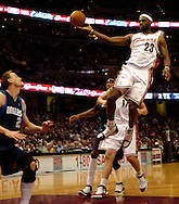 PHOTO BY DAVID RICHARD.LeBron James dishes off a no-look pass last night against Dallas.