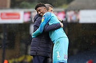 AFC Wimbledon goalkeeper Nathan Trott (1) hugging and celebrating after win during the EFL Sky Bet League 1 match between Southend United and AFC Wimbledon at Roots Hall, Southend, England on 12 October 2019.