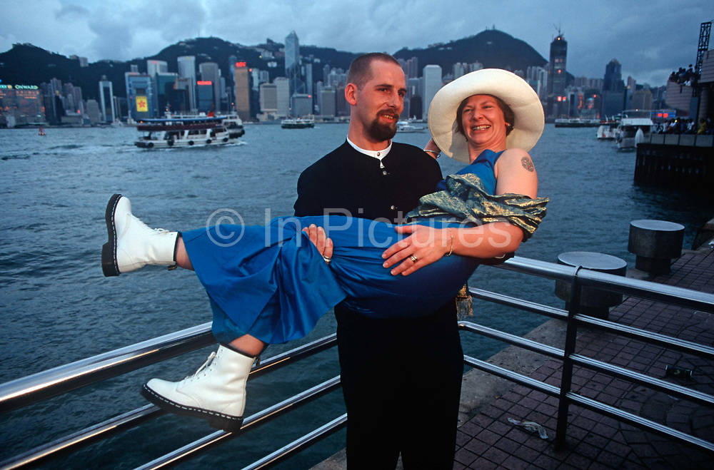 While still a British colony, a Western couple stand with a backdrop of Hong Kong Harbour waters, on 21st April 1995, in Kowloon, Hong Kong, China.