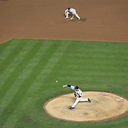 Pitcher Matt Harvey, New York Mets, pitching with David Wright at third base during the New York Mets V Arizona Diamondbacks Major League Baseball game at Citi Field, Queens, New York. USA. 3rd July 2013. Photo Tim Clayton