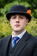 Portrait of Orangeman wearing the traditional bowler hat with orange rose.  July 2021