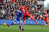 Cardiff City's Anthony Pilkington (l) takes the ball past Bristol's Aden Flint. EFL Skybet championship match, Bristol City v Cardiff City at the Ashton Gate Stadium  in Bristol, Avon on Saturday 14th January 2017.<br /> pic by Carl Robertson, Andrew Orchard sports photography.
