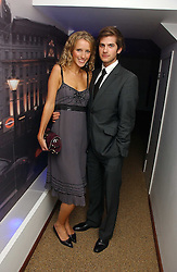 KATE MELHUISH and JACK FREUD at a party to celebrate the publication of Tatler's Little Black Book 2006 held at 24, 24 Kingley Street, London W1 on 9th November 2006.<br />