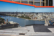 A construction hoarding showing grand aerial views from the top of One Blackfriars on the Southbank, on 8th May 2017, in London, England.