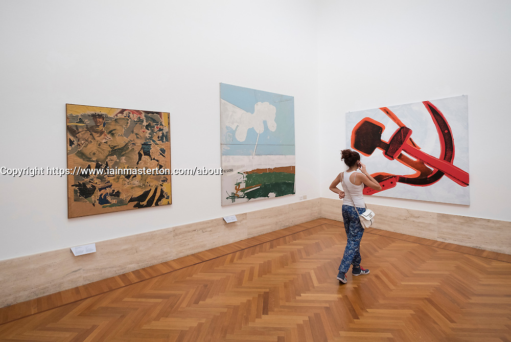Visitor looking at paintings at National Gallery of Modern and Contemporary Art Rome Italy