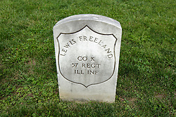 26 August 2017:   A part of the History of McLean County Illinois.<br /> <br /> Tombstones in Evergreen Memorial Cemetery.  Civic leaders, soldiers, and other prominent people are featured. Section 5, the old town soldiers area<br /> Lewis Freeland  Co K  57 Regt  IL INF