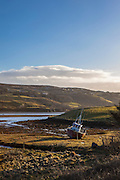 Beached fishing boat in Teelin Bay, near Carrick, Donegal, Ireland