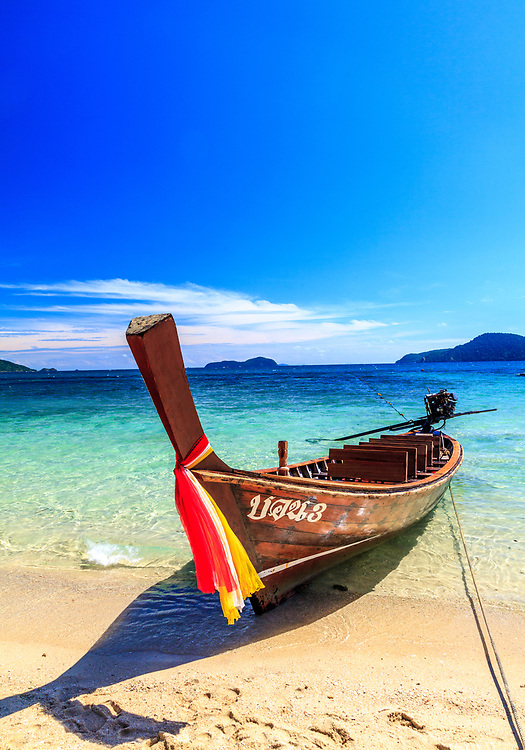 The long-tail boat or Ruea Hang Yao in Phuket, Thailand. Long Tail boat concept was developed in Thailand as a simple, low-cost means of motorizing vessels, used in rivers, canals, and oceans where people and cargo must be transported through shallow waterways.