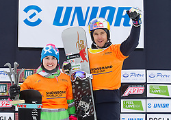 Overall leaders Ekaterina Tudegesheva of Russia and Roland Fischnaller of Italy celebrate at flower ceremony after   the FIS Snowboard World Cup Rogla 2013 in Parallel Giant slalom, on February 8, 2013 in Rogla, Slovenia. (Photo By Vid Ponikvar / Sportida.com)
