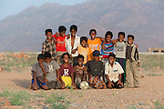 Group portrait of young boys soccer team in Hadibu, Socotra, Yemen