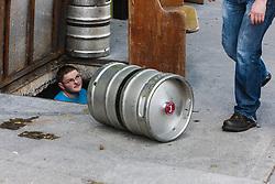 Men loading Guinness kegs intoThe Clock Tavern, Westport, County Mayo, Ireland