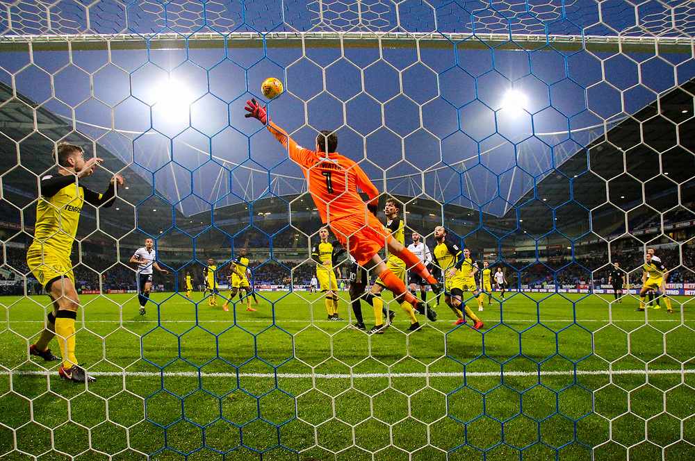 Burton Albion's Stephen Bywater reaches out to stop Bolton Wanderers' David Wheater's header<br /> <br /> Photographer Alex Dodd/CameraSport<br /> <br /> The EFL Sky Bet Championship - Bolton Wanderers v Burton Albion - Saturday 16th December 2017 - Macron Stadium - Bolton<br /> <br /> World Copyright © 2017 CameraSport. All rights reserved. 43 Linden Ave. Countesthorpe. Leicester. England. LE8 5PG - Tel: +44 (0) 116 277 4147 - admin@camerasport.com - www.camerasport.com