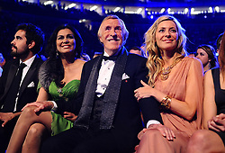 File photo dated 26/01/11 of Sir Bruce Forsyth (centre) and his wife Wilnelia (left) sitting with Tess Daly as he wins a Special Recognition award, at the 2011 National Television Awards at the O2 Arena, London, as the veteran entertainer has died aged 89.