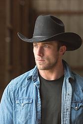 portrait of an All American Cowboy in a barn