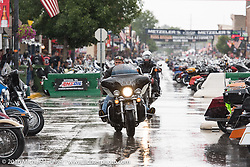 Braving the rain on Main Street during the annual Sturgis Black Hills Motorcycle Rally. SD, USA. Thursday, August 11, 2016. Photography ©2016 Michael Lichter.