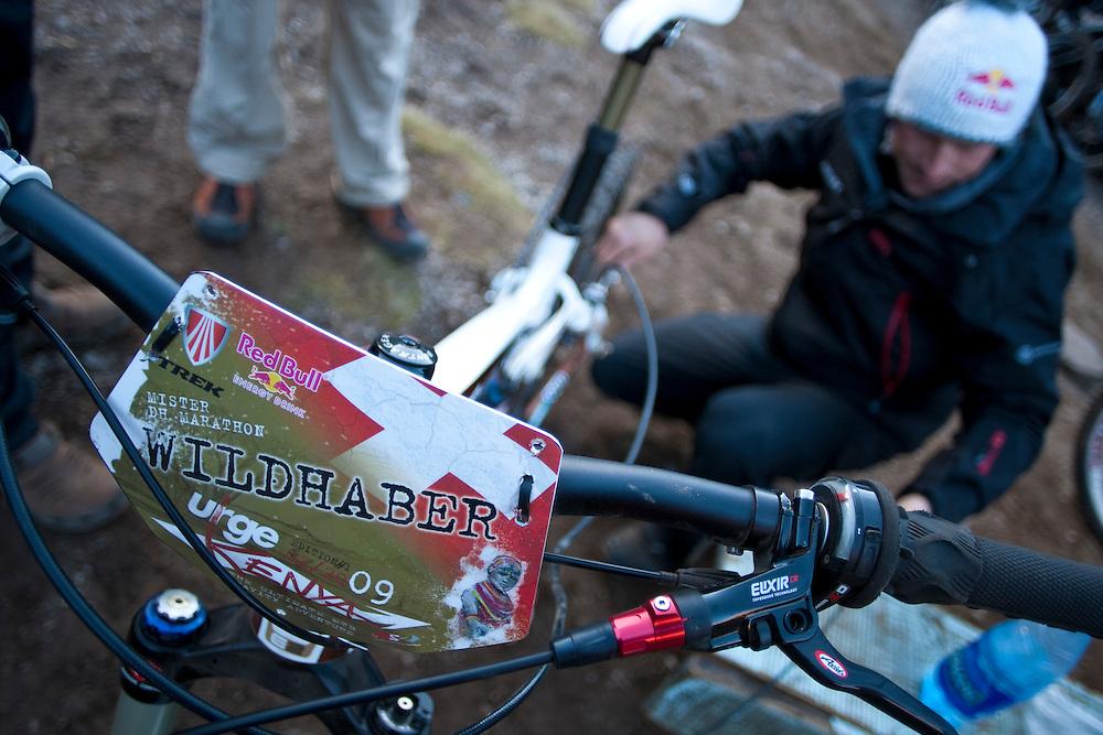 Location: Mont Kenya (Kenya) Urge Kenya 09/ The ultimate Mountain Bike gravity adventure at Mont-Kenya Athlete: Rene Wildhaber at Shipton Camps (altitude 4200 meters) fix his bike