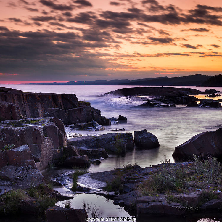 The Lake Superior shoreline offers endless possibilities for great sunsets with powerful foregrounds year 'round. This view is available in late September.
