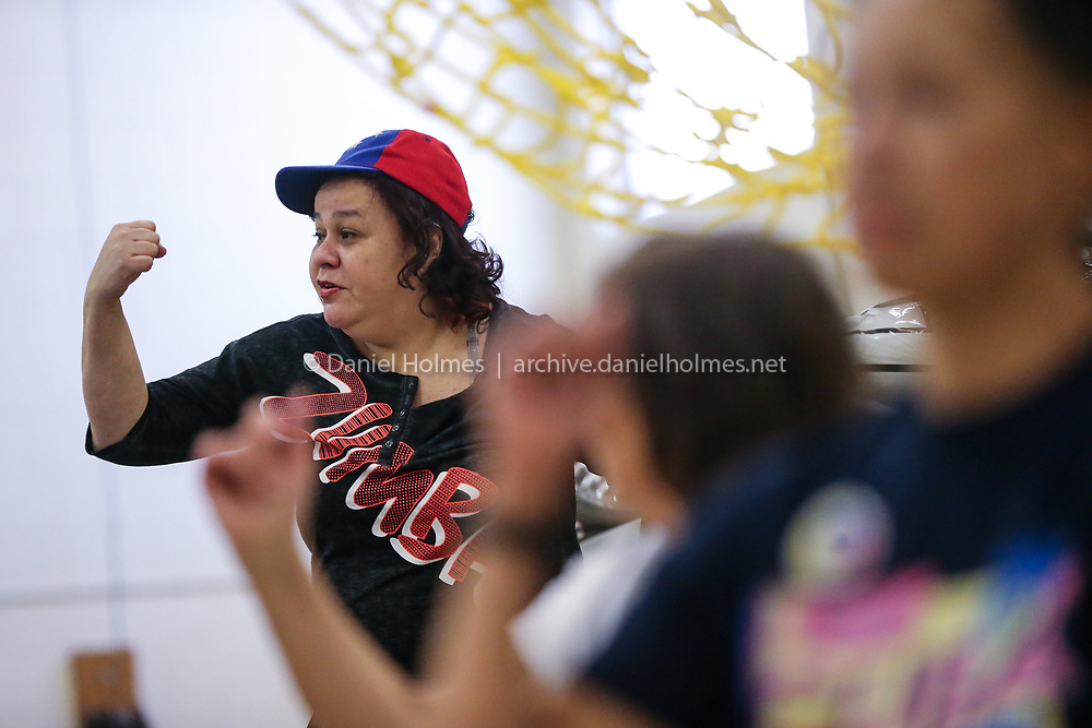 """(2/10/19, FRAMINGHAM, MA) Zumba instructor Martha Convers leads a Zumba class during the """"Shoes for Venezuela""""  event at the Barbieri Elementary School in Framingham on Sunday. [Daily News and Wicked Local Photo/Dan Holmes]"""