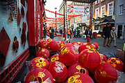 Red Chinese lanters on Gerrard Street in preparation for the upcoming Chinese New Year celebrations in Chinatown in London, England, United Kingdom.