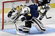 Notre Dame's Colin Theisen (13) collides with Providence goaltender Hayden Hawkey (31) during the first period of an NCAA college hockey regional tournament game, Saturday, March 24, 2018, in Bridgeport, Conn. Theisen was charged with the penalty of goaltender interference. (AP Photo/Jessica Hill)