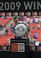 Chelsea's John Terry holds the Community Shield trophy<br /> Manchester United vs Chelsea<br /> The FA Community Shield, Wembley Stadium, London, UK<br /> 09/08/2009. Credit Colorsport/Dan Rowley