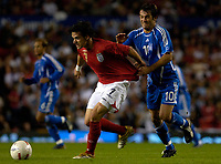 Photo: Daniel Hambury.<br />England v Greece. International Friendly. 16/08/2006.<br />England's Owen Hargreaves battles with Greece's Georgios Karagkounis.