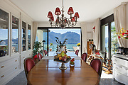 Interior of house, table and chairs of a dining room, classic decor