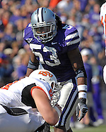 Kansas State linebacker Reggie Walker (53) looks in at Oklahoma State quarterback Bobby Reid (14) in the first half at Bill Snyder Family Stadium in Manhattan, Kansas, October 7, 2006.  The Wildcats beat the Cowboys 31-27.<br />
