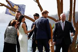 The Duke and Duchess of Sussex with Australia's Governor General Peter Cosgrove (right) in the grounds of Admiralty House in Sydney on the first day of the royal couple's visit to Australia.